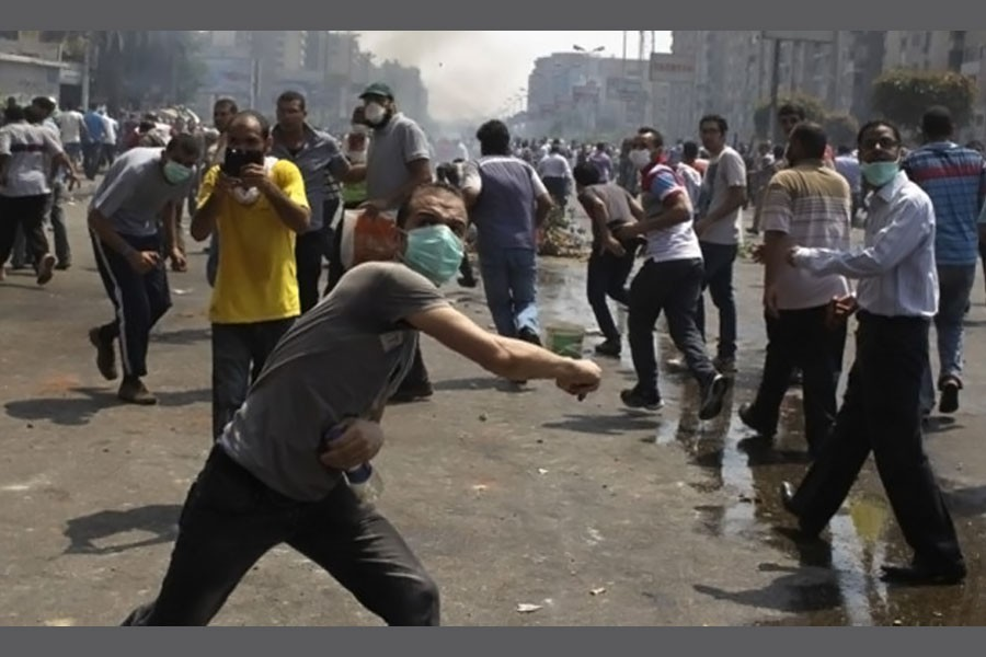 Members of the Muslim Brotherhood throw stones at riot police and army personnel during clashes in Cairo. (Reuters photo used for representation)