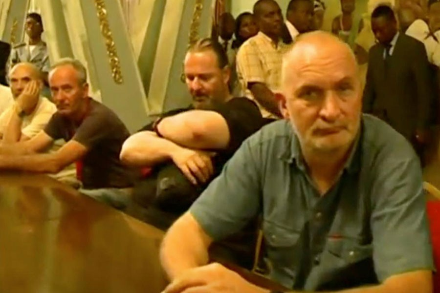 Tourists, who were held hostage, sit after they were freed in Yaounde, Cameroon April 3, 2018 in this picture taken from video. Reuters.