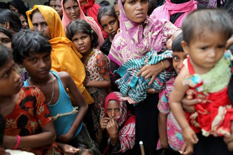 Amnesty says there were many children among the Hindus killed. Nearly 700,000 Rohingya, many of them women and children, have fled to Bangladesh since August. Reuters/File