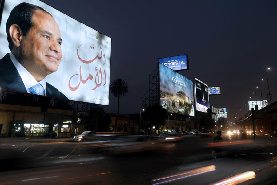 A Cairo street sign showing Egypt's President Abdel Fattah al-Sisi ahead of the presidential election, March 25, 2018. Reuters file photo.