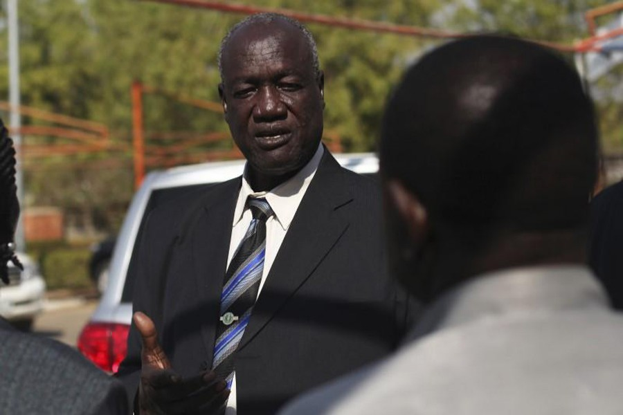 South Sudan's Defence Minister Kuol Manyang Juuk, talks to cabinet members after a cabinet meeting in Juba January 17, 2014. Reuters/File