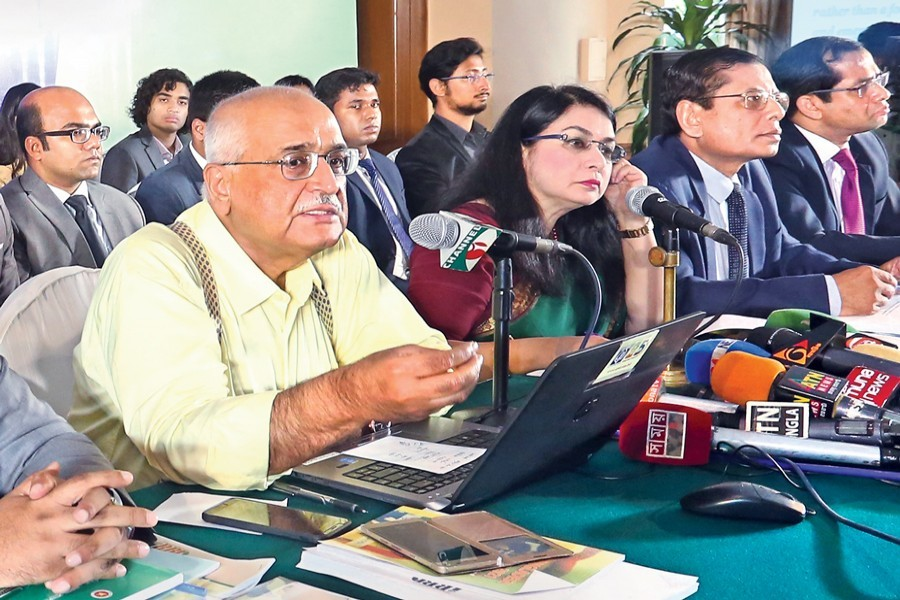 Centre for Policy Dialogue (CPD) Distinguished Fellow Dr Debapriya Bhattacharya speaking at a press briefing in the city on Friday — FE photo