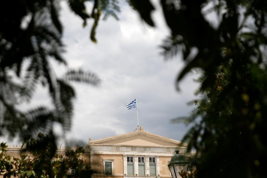 A Greek flag flutters atop the parliament building in Athens, Greece, June 21, 2018. Reuters