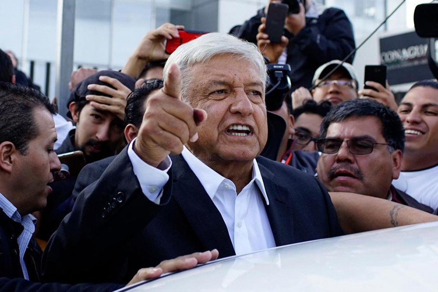 Presidential candidate Andres Manuel Lopez Obrador talks to reporters as he departs after casting his ballot at a polling station during the presidential election in Mexico City, Mexico on Sunday - Reuters photo