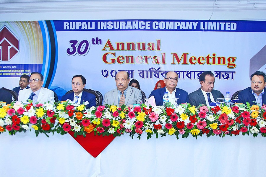 Chairman of Rupali Insurance Company Mostafa Golam Quddus presiding over the 30th annual general meeting (AGM) of the company in the city recently while Management & Financial Consultant M. Azizul Huq and Chief Executive Officer P. K. Roy, FCA were present