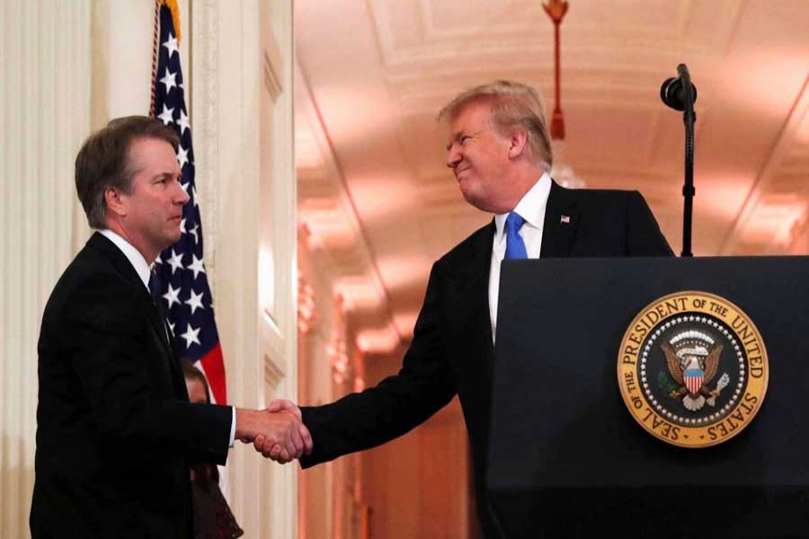 US President Donald Trump introduces his Supreme Court nominee judge Brett Kavanaugh (L) in the East Room of the White House in Washington, US, July 9, 2018. Reuters