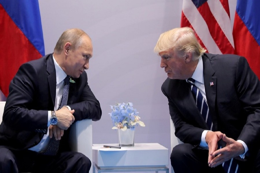 Russia's President Vladimir Putin talks to US President Donald Trump during their bilateral meeting at the G20 summit in Hamburg, Germany, Jul 7, 2017. Reuters/Files