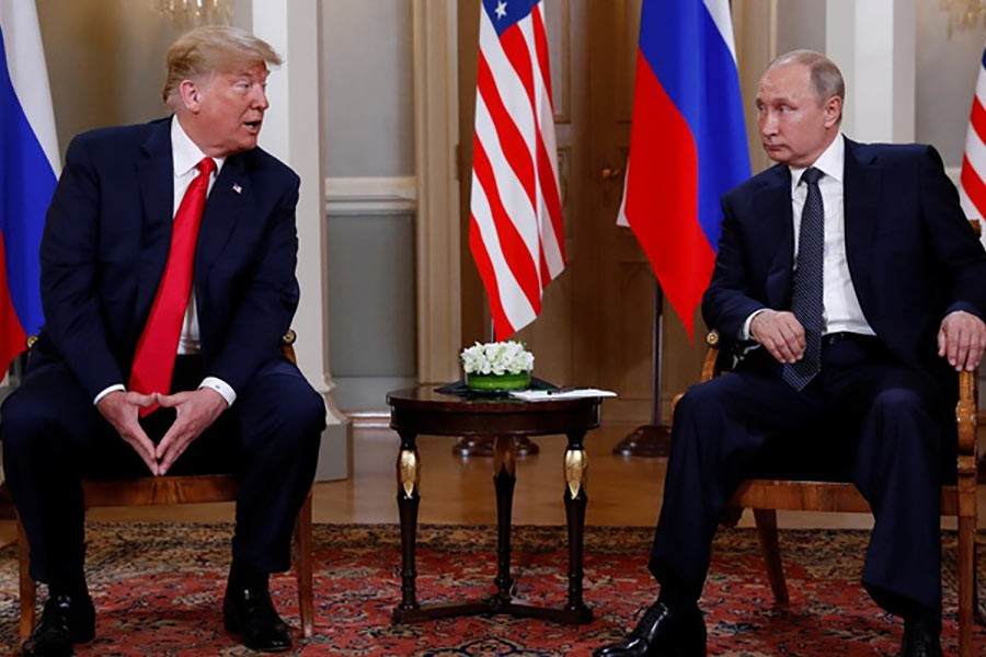 US President Donald Trump meeting with Russia's President Vladimir Putin in Helsinki of Finland on Monday. -Reuters Photo