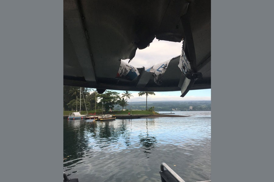 A hole, punched through the roof of a tourist boat, is seen, after lava from the Mount Kilauea volcano exploded in the sea off Kapoho, Hawaii, US July 16, 2018 - Hawaii Department of Land and Natural Resources/Handout via Reuters