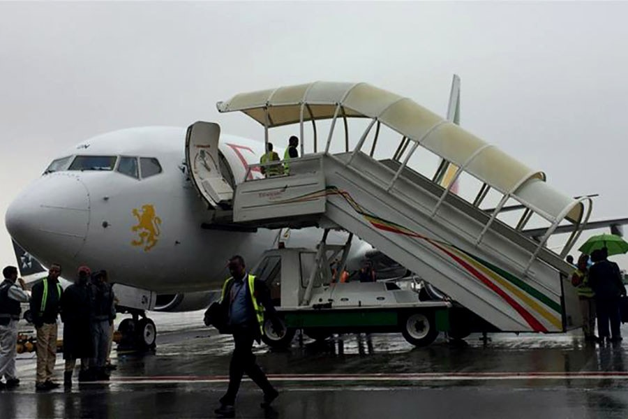 Ethiopian Airlines staff preparing their plane as they resume flights to Eritrea's capital Asmara at the Bole International Airport in Addis Ababa of Ethiopia on Wednesday. -Reuters Photo