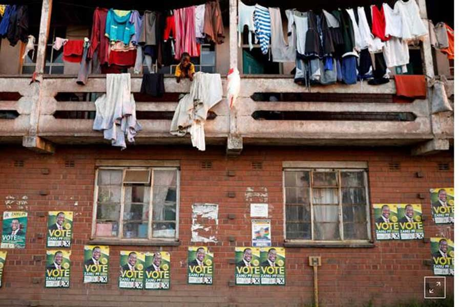 Election posters are pictured on the walls of apartments in Mbare township in Harare, Zimbabwe, July 29, 2018. Reuters