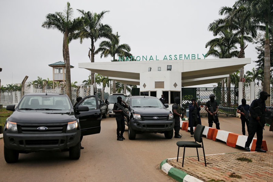 Members of security forces block the entrance of the National Assembly in Abuja, Nigeria on Tuesday — Reuters