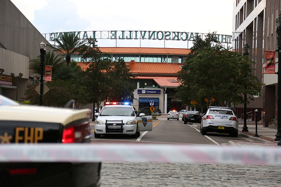 Police officers cordon off a street outside The Jacksonville Landing after a shooting during a video game tournament in Jacksonville, Florida on Sunday — Reuters photo