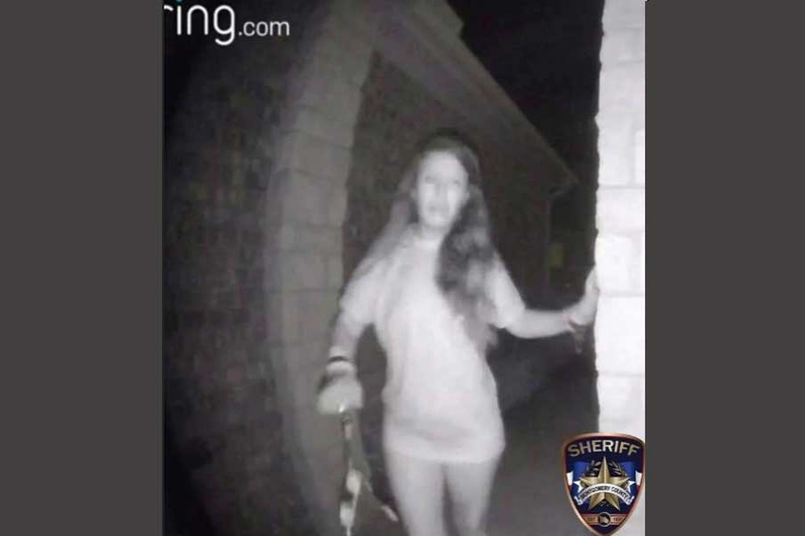 An image of a partially dressed woman, with what appear to be broken restraints dangling from her wrists, is seen in a still image from security camera video released by the Montgomery County Sheriff's Office in Montgomery County, Texas, US, on August 26, 2018 and obtained by Reuters August 28, 2018. Courtesy Montgomery County Sheriff's Office/Handout via Reuters