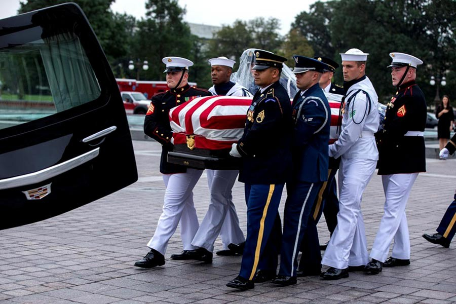 Joint service members of a military casket team carrying the casket of Senator John McCain for a motorcade that will ferry him to a funeral service at the National Cathedral in Washington on Saturday. -Reuters Photo