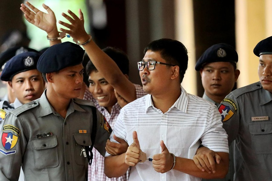 Detained Reuters journalists Wa Lone and Kyaw Soe Oo arrive at Insein court in Yangon, Myanmar on Monday — Reuters photo