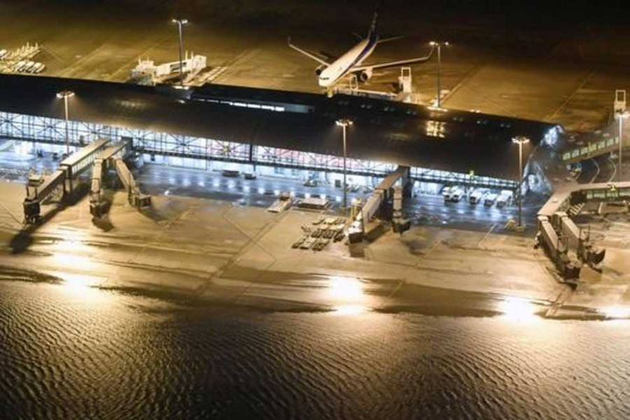 The runway at Kansai airport was flooded          -Reuters