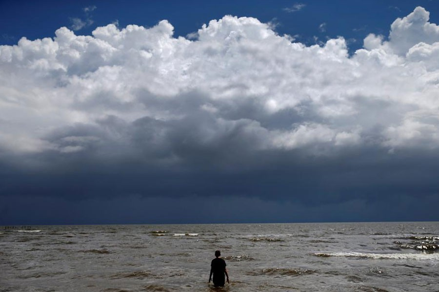 15-year-old Jordan Carambat wades in the ocean as Tropical Storm Gordon approaches Waveland, Mississippi, US, September 4, 2018 – Reuters