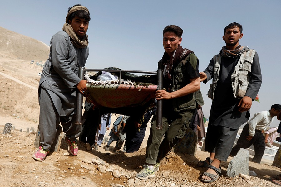 The wounded being moved on makeshift stretchers after suicide bombers killed 20 and injured 70 in Afghan capital Kabul on Wednesday — Reuters photo