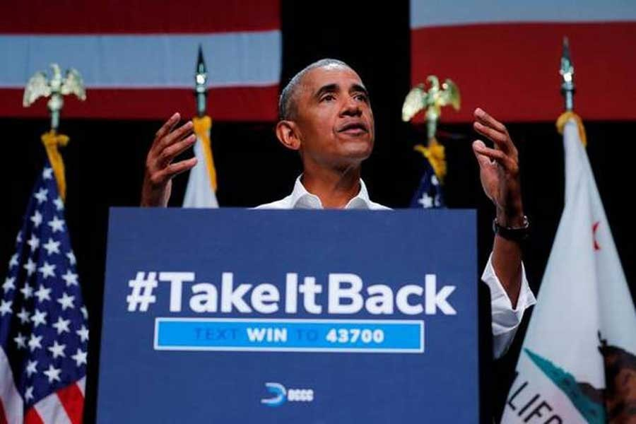 Obama takes swipe at Trump in political rally