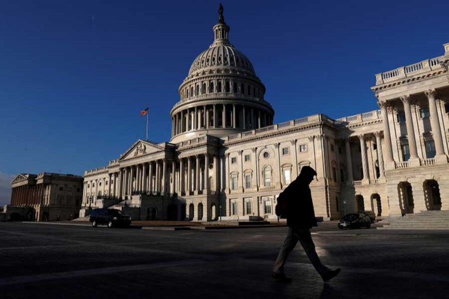 People walk by the US Capitol building in Washington, US, February 8, 2018. Reuters/Files