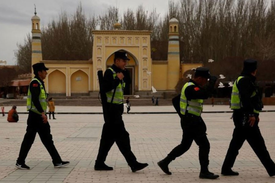 A police patrol walk in front of the Id Kah Mosque in the old city of Kashgar, Xinjiang Uighur Autonomous Region, China, March 22, 2017 – Reuters file photo