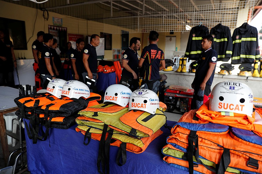 Rescuers ready their gear before Super Typhoon Mangkhut hits the main island of Luzon, in Muntinlupa, Metro Manila, in Philippines on Thursday — Reuters photo