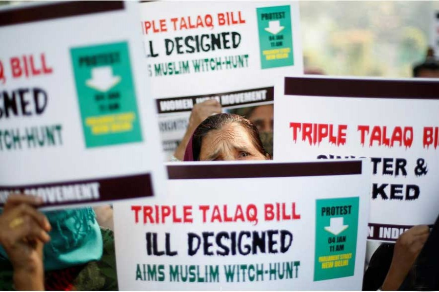 "Muslim women hold placards during a protest against a bill passed by India's lower house of Parliament last week that aims at prosecuting Muslim men who divorce their wives through the ""triple talaq,"" or instant divorce, in New Delhi, India Jan 4, 2018.  - Reuters"
