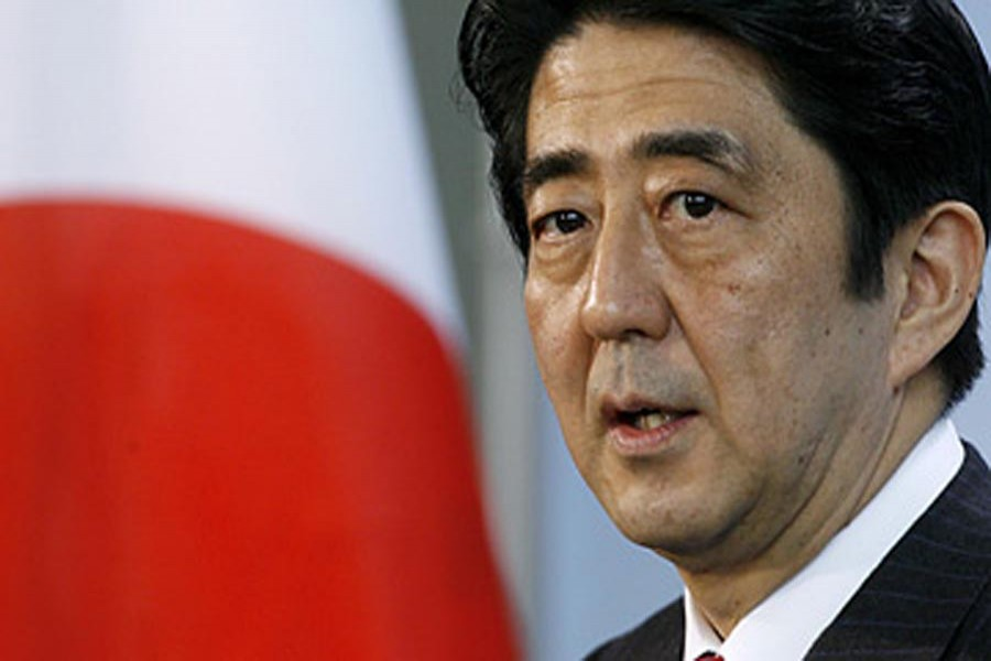 Japan's Abe re-elected as party head, to stay on as PM