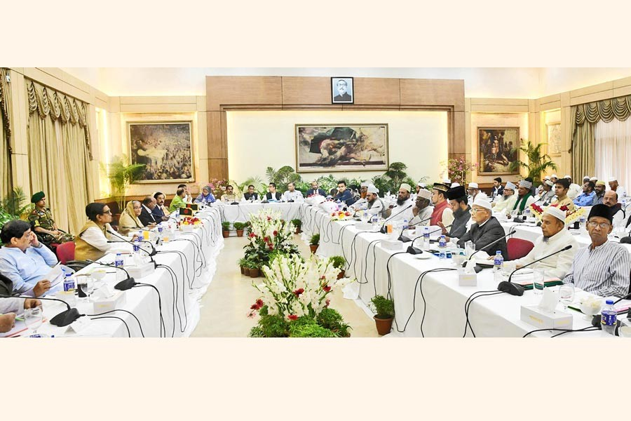 The 14-party alliance led by Prime Minister Sheikh Hasina holding talks with Islami Oikyajote, a coalition of eight Islamic parties, over upcoming election at Ganobhaban in the city on Tuesday — Focus Bangla