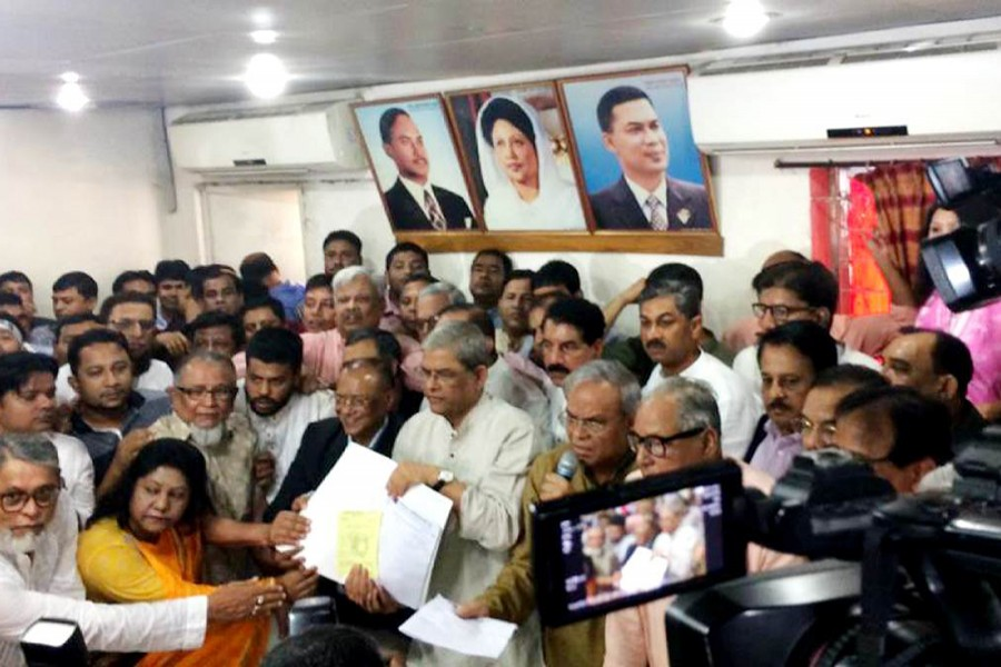 BNP secretary general Mirza Fakhrul Islam Alamgir collects nomination form at the party's central office at Nayapaltan in Dhaka city. File photo