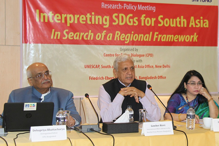 International Affairs Adviser to the Prime Minister Gowher Rizvi speaking at a research-policy meeting on 'Interpreting SDGs for South Asia: In Search of a Regional Framework' organised by Centre for Policy Dialogue at a city hotel on Tuesday — FE photo