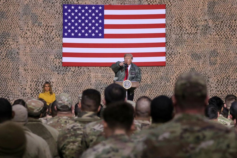 US President Donald Trump, with first lady Melania Trump, delivers remarks to US troops in an unannounced visit to Al Asad Air Base, Iraq, December 26, 2018 - REUTERS/Jonathan Ernst