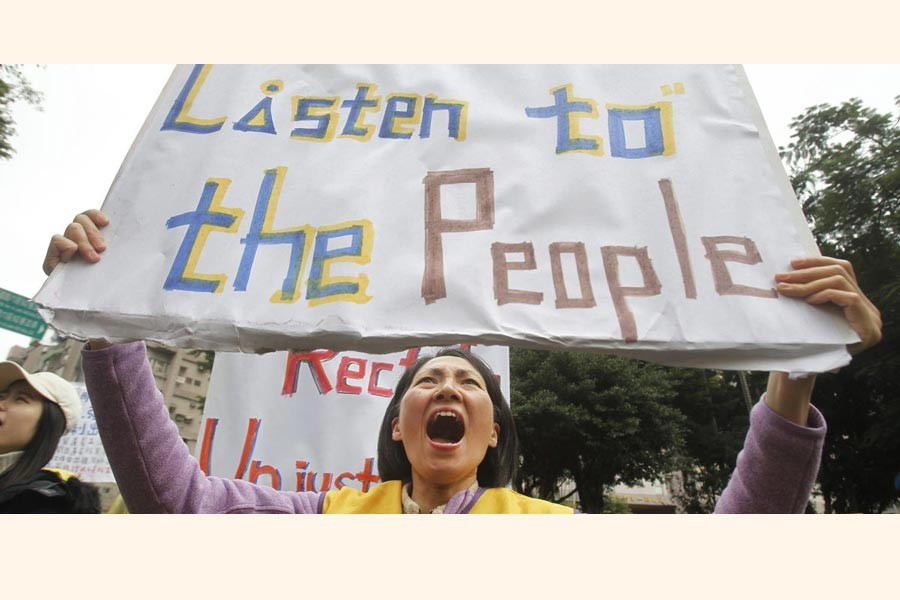 TAIPEI: A protester shouting slogans demanding tax reform outside the Ministry of Finance in Taipei on Thursday— AP
