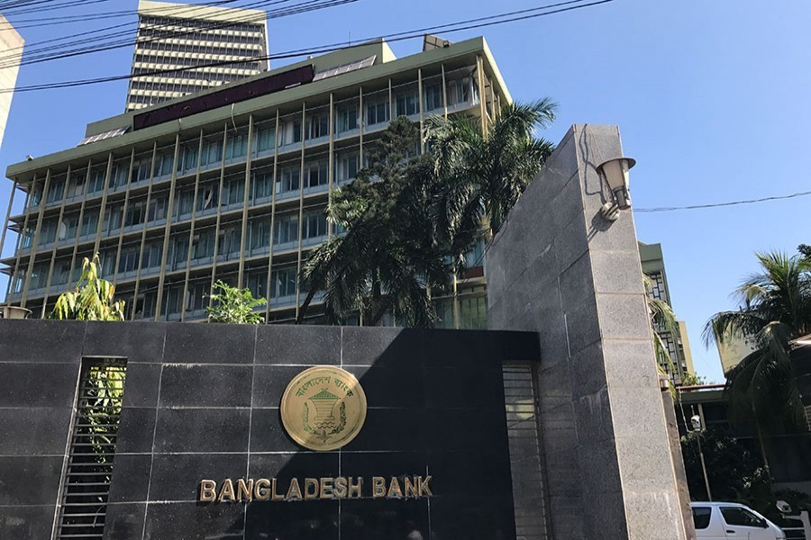 The Bangladesh Bank seal is pictured on the gate outside the central bank headquarters in Motijheel, the bustling commercial hub in capital Dhaka. Photo: FE