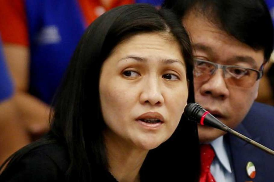Maia Santos Deguito, branch manager of the Rizal Commercial Banking Corp (RCBC) answers questions during a money laundering hearing at Senate in Manila April 5, 2016. At right is her legal counsel Fernando Topacio. - Reuters