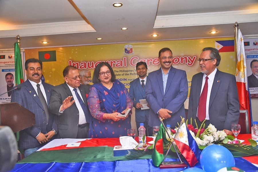 Chittagong City Corporation Mayor A J M Nasir Uddin, Philippines' Ambassador to Bangladesh Vincente Vivencio T Bandillo, Honorary Consul of the Philippines Mohammed A Awwal and others in a photo session at the inauguration of the Philippines' visa centre in the port city recently