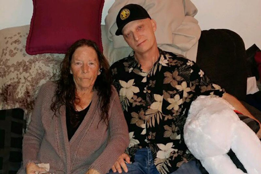 Michael White of California poses with his mother Joanne in an undated family photo released in Washington, US March 16, 2019 - White family/Handout via REUTERS