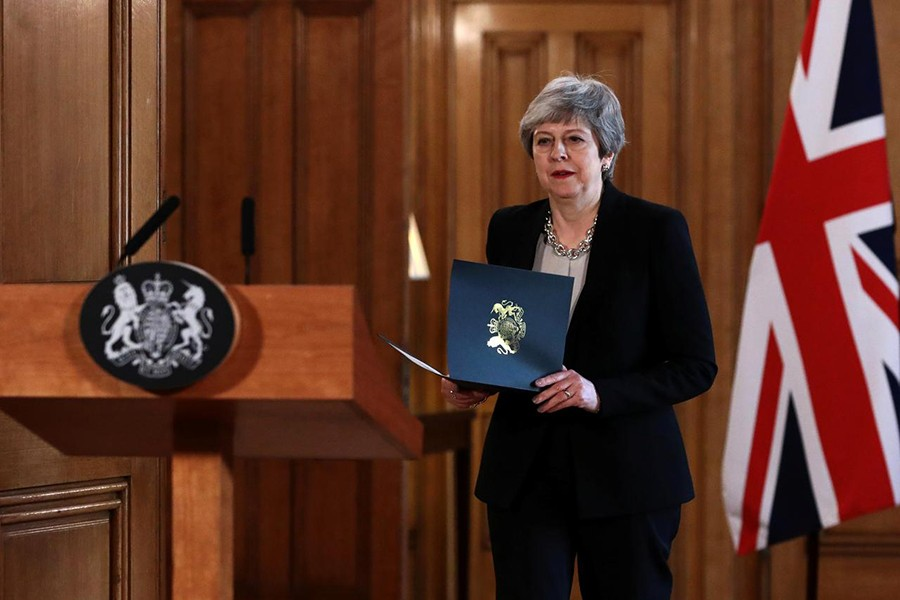 British Prime Minister Theresa May holds documents at a news conference outside Downing Street, London, Britain on April 2, 2019 — Reuters photo
