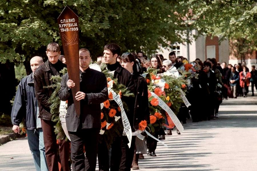 File Photo: A funeral procession for prominent Serbian opposition journalist Slavko Curuvija, owner of the daily Dnevni Telegraf, who was killed in Belgrade on April 11. Belgrade, Serbia, April 14, 1999. -Reuters Photo