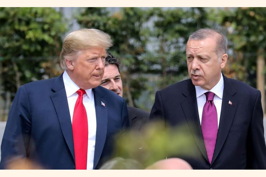 A file photo showing US President Donald Trump (left) talking with Turkey's President Tayyip Erdogan during the opening ceremony of the NATO (North Atlantic Treaty Organisation) summit, at the NATO headquarters in Brussels, Belgium recently	— Reuters