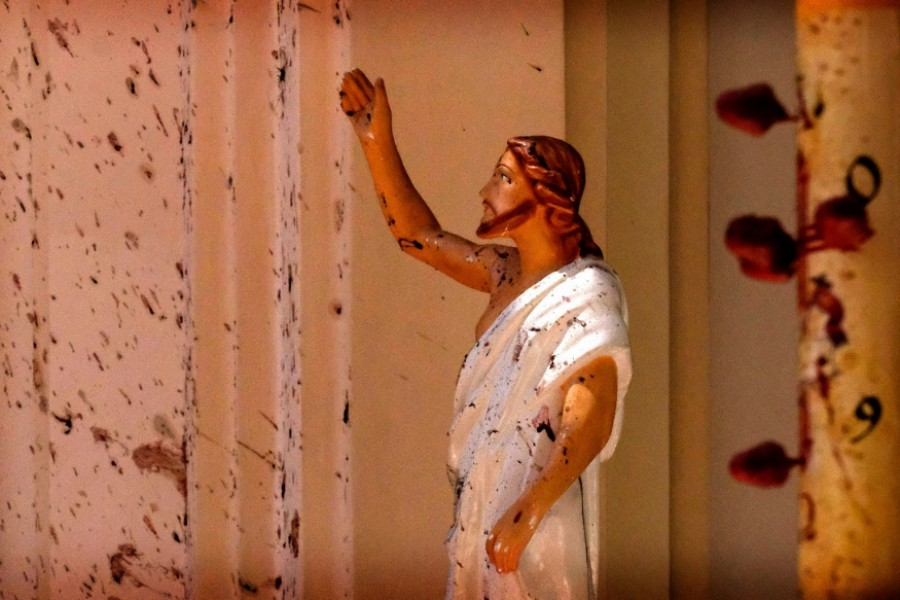 Out of all the images that have been widely circulated online, there is one particular image that has almost gained symbolic status. It is an image of the statue of Jesus, stained with blood, in the aftermath of the blast. - news18.com