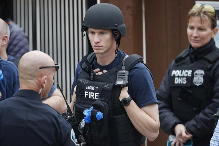 Policemen gather at the recreation centre where students were reunited with their parents after a shooting at a suburban Denver middle school Tuesday, May 7, 2019, in Highlands Ranch, Colorado — AP photo