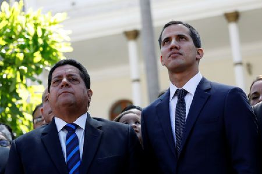 Juan Guaido (R), new President of the National Assembly and lawmaker of the Venezuelan opposition party Popular Will (Partido Voluntad Popular), and lawmaker Edgar Zambrano of Democratic Action party (Accion Democratica), leave the congress after Guaido's swearing-in ceremony, in Caracas, Venezuela January 5, 2019. Reuters