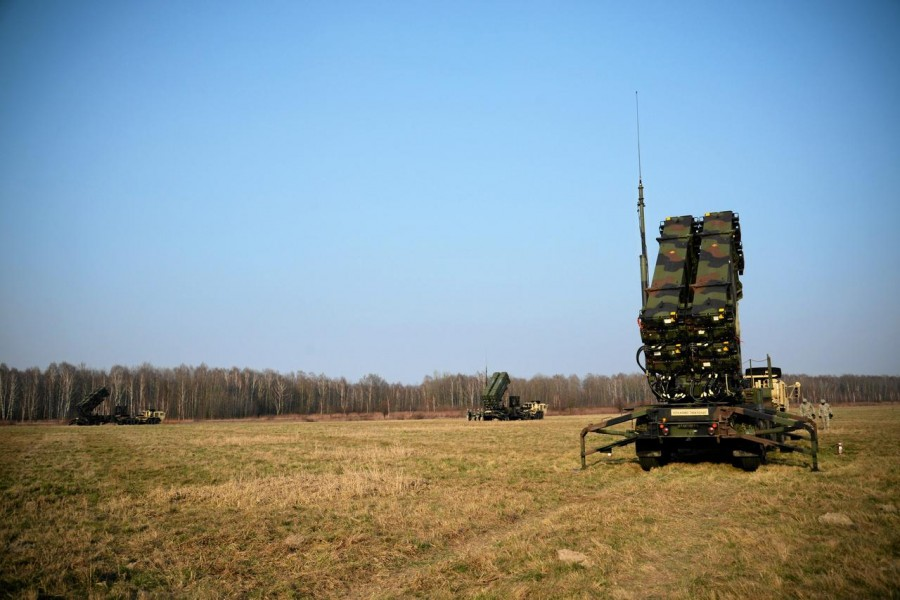 US soldiers walk next to a Patriot missile defence battery during join exercises at the military grouds in Sochaczew, near Warsaw, March 21, 2015 - Reuters file photo
