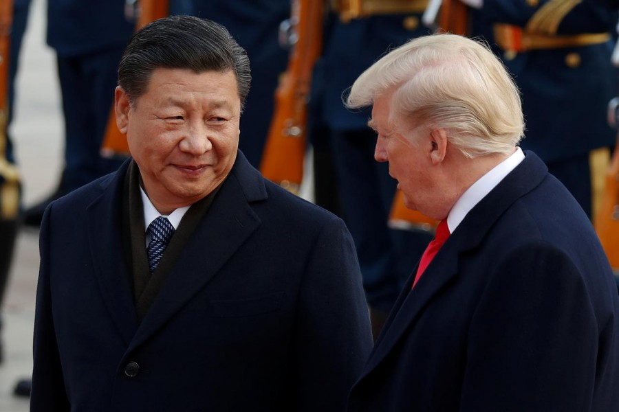 US President Donald Trump takes part in a welcoming ceremony with China's President Xi Jinping at the Great Hall of the People in Beijing, China, November 9, 2017. Reuters/File Photo