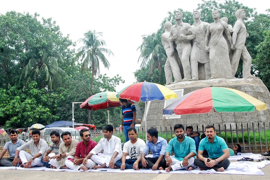 A group of Bangladesh Chhatra League (BCL) leaders, who were allegedly overlooked for posts in the central committee of the ruling party's student wing, seen in a sit-in protest in front of Raju Sculpture in Dhaka University — Focus Bangla file photo