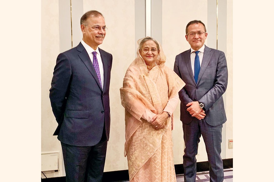 Prime Minister Sheikh Hasina is flanked by Jun Nishizawa, Group CEO of Natural Gas Group of Mitsubishi Corporation, and Muhammed Aziz Khan (left), Founder Chairman of Summit Group, in a meeting in Tokyo on Thursday