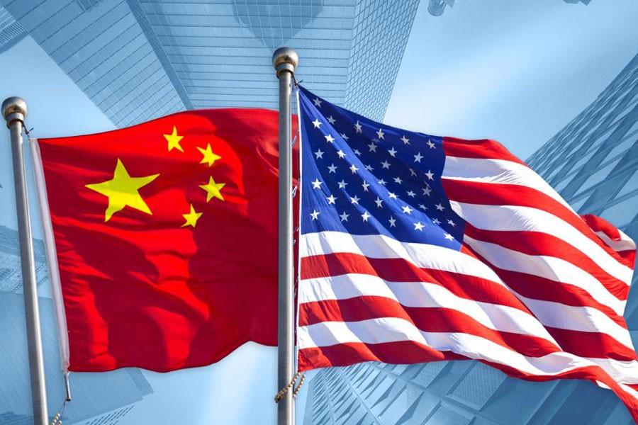 China warns its companies on US travel