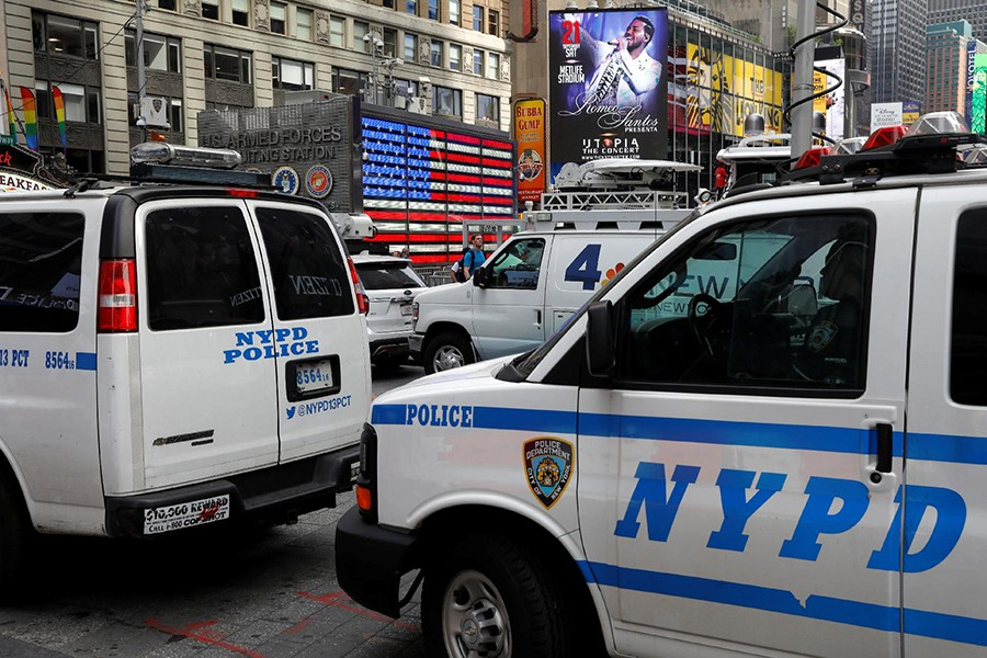 New York City Police Department (NYPD) vehicles patrol in Time Square after a man was arrested in an alleged plot to buy grenades for an attack on Times Square in New York, US on Firday — Reuters photo